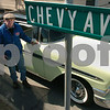 "Peabody:<br /> Billy Dunn created a street sign that says, ""Chevy St."" because of his love of Chevys. He is standing next to his classic 56 Chevy BelAir in his driveway.<br /> Photo by Ken Yuszkus/Salem News, Friday, March 20, 2009."