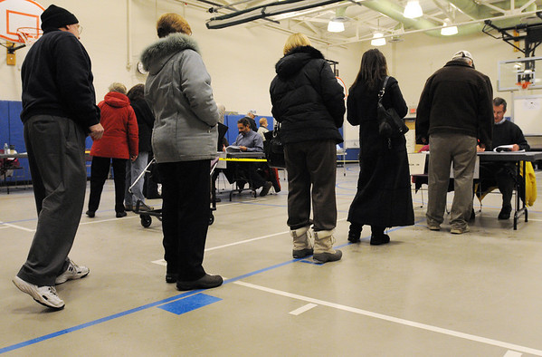 Beverly:<br /> People line up to register to vote at the North Beverly Elementary School. Despite the lght snow that fell during the day, voters still came out to vote<br /> Photo by Ken Yuszkus/Salem News, Monday, January 19, 2010.