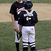Salem:<br /> Swampscott's pitcher Chris Murphy, left, speaks with catcher Ben Rossman on the pitcher's mound  during the Gallant Memorial youth baseball tournament final at Forest River Park, Salem between Danvers and Swampscott.<br /> Photo by Ken Yuszkus/Salem News, Tuesday August 17, 2010.