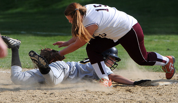 Peabody:<br /> Chelmsford's Jill Montuori tries to tag Bishop Fenwick's Allissa Bornstein as she dives back safely to first base in a pick off attempt in the Chelmsford at Bishop Fenwick softball game.<br /> Photo by Ken Yuszkus/Salem News, Friday, May 14, 2010.