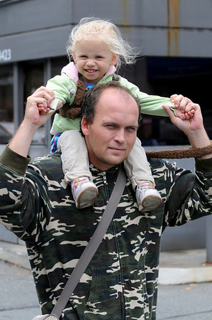 Salem:<br /> Eva McCoy, 2, gets a ride on her father's, Brian McCoy, back as he walks down Congress Street in Salem on Tuesday.<br /> Photo by Ken Yuszkus/Salem News, Tuesday, September 6, 2011.