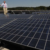 Ipswich:<br /> Robert Markel, Ipswich Town Manager, walks amongst some of the newly installed 160 solar panels on the roof of Ipswich City Hall which produce electricity.<br /> Photo by Ken Yuszkus/Salem News, Thursday,  August 19, 2010.