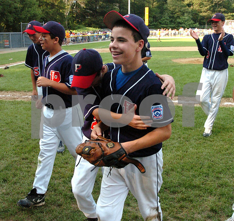 Beverly:<br /> Right, Peabody West's pitcher Nick Bona gets a hug from J.J. Layton while walking off the field at the end when they won  the State Little League championship game of Peabody West vs Newton Central at Harry Ball Field.<br /> Photo by Ken Yuszkus/Salem News, Monday, August 3, 2009.