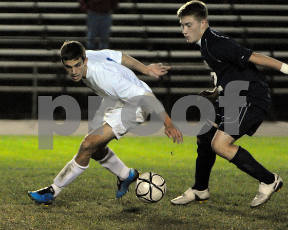 Danvers:<br /> Christopher Ciampa, left, of Danvers High School, leans into the ball with Justin Peluso of St. John's Prep, right by his side during the boys soccer game at Deering Stadium at Danvers High School.<br /> Photo by Ken Yuszkus/Salem News, Monday October 12, 2009.
