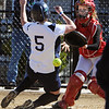 Beverly:<br /> Endicott College's Megan Downey slides successfully home past Eastern Nazarene College's catcher, Laura Giberson. It was the first run for Endicott College.<br /> Photo by Ken Yuszkus/Salem News, Friday, April 2, 2010.