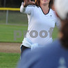 Beverly:<br /> Bethanie McNinch throws a softball at the beginning of the softball clinic at Harry Ball Field.  The Beverly softball team is teaming up with mothers to teach them how to bat and throw a ball in preparation for the upcoming Momball fundraiser.<br /> Photo by Ken Yuszkus/Salem News, Tuesday, September 15, 2009.