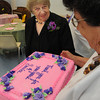 "Hamilton:<br /> Mary Maione, left, looks over the cake which thanks her for years of service was displayed by Mimi Fanning, chairman of the Council on Aging. Mary Maione, a longtime volunteer with Hamilton's Council on Aging, is retiring as a member of the Hamilton Council on Aging's board of directors.  Selectmen have declared Monday as ""Mary Maione Day"" at a reception held in her honor.<br /> Photo by Ken Yuszkus/The Salem News, Monday, September 5, 2012."