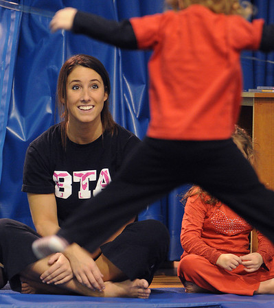 Swampscott:<br /> Jennifer Burke, owner of Burke's Tumbling Academy, instructs the class of 3- and 4-year-olds on the trampoline. <br /> Photo by Ken Yuszkus/Salem News, Monday, January 3, 2011.
