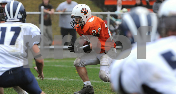 Beverly:<br /> Beverly's Dylan Terry runs the ball through the Swampscott's defense during the second quarter at the Swampscott at Beverly football game on Saturday.<br /> Photo by Ken Yuszkus/Salem News, Saturday, November 8, 2008.
