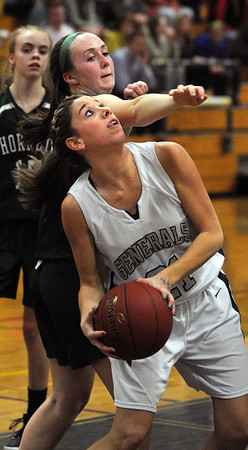 Hamilton:<br /> Hamilton-Wenham's Victoria Tansey looks for the hoop as Manchester Essex' Jess Crossen tries to block during the Manchester Essex at Hamilton-Wenham girls basketball game.<br /> Photo by Ken Yuszkus/Salem News, Monday, February 6, 2012.