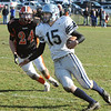Ipswich:<br /> Hamilton-Wenham's Steve Brao runs the ball as Ipswich's Joe Perkins looms behind him during the Hamilton-Wenham at Ipswich football game on Thanksgiving Day.<br /> Photo by Ken Yuszkus/Salem News, Thursday, November 24, 2011.