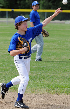 Topsfield:<br /> Brandon LaFata, of the Topsfield Little League, gets some fielding practice during practice for the District 15 tourney.<br /> Photo by Ken Yuszkus/Salem News, Tuesday, June 28, 2011.