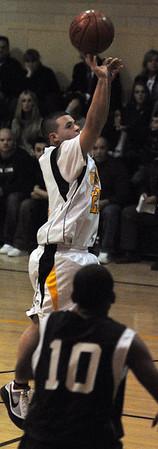 Peabody:<br /> Bishop Fenwick's David Ruggiero shoots for a basket during the North Cambridge Catholic at Bishop Fenwick boys basketball game.<br /> Photo by Ken Yuszkus/Salem News, Tuesday, December 22, 2009.