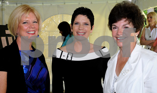 Danvers:<br /> From left, Jeanne Hennessey, Amanda Smith, and Sharon Taskey, chairman, all of Danvers, attend the Danvers Historical Society fashion show and fundraiser held at Glen Magna Farms. <br /> Photo by Ken Yuszkus/Salem News,  Wednesday, June 3, 2009.