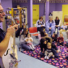 Peabody:<br /> Peter Sheridan sings traditional songs and holiday favorites to small children and their parents at the Peabody Institute Library children's room.<br /> Photo by Ken Yuszkus/Salem News, Tuesday, Decmber 8, 2009.
