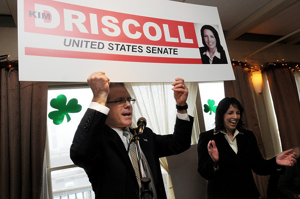 Salem:<br /> Rep. John Keenan holds up a political poster poking fun at Salem Mayor Kim Driscoll's political aspirations during  Rep. John Keenan's annual St. Patrick's Day breakfast held at Finz restaurant on Friday morning.<br /> Photo by Ken Yuszkus/Salem News, Friday, March 11, 2011.