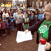 Salem:<br /> Pat Cassidy, troop leader, leads the group in songs before they recited the Girl Scout pledge to celebrate the 100th anniversary of the organization. The group gathered near the flag poles across from the Salem Post Office.<br /> Photo by Ken Yuszkus/Salem News, Monday,  March 12, 2012.