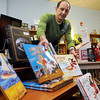 Ipswich:<br /> Paul D. Allen-Webber, left, Owner/Manager,<br /> and Meg Richardson, book buyer and asst. manager, arrange books at the Book Nook at River's Edge, which is a book store opening in Ipswich, <br /> Photo by Ken Yuszkus/Salem News, Friday, April 1, 2011.