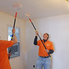 Salem:<br /> Mike Raymond, left, and Geoff Sheehan, Home Depot personnel, paint the new sheetrock on the ceiling on the third floor during the community renovation project at the Plummer Home for Boys in Salem on Thursday.<br /> Photo by Ken Yuszkus/Salem News, Thursday, April 21, 2011.