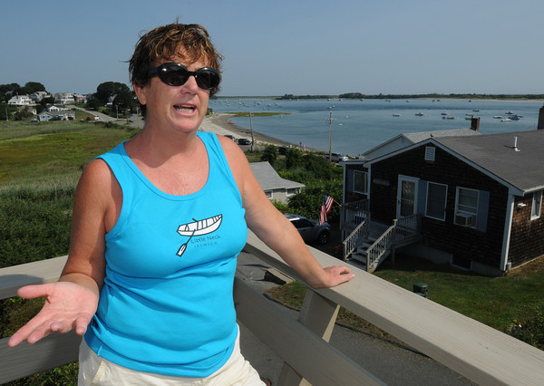 Ipswich:<br /> Ellen Perry, a longtime resident of Little Neck, stands on her deck overlooking Pavillion Beach and talks about last week's sale of the peninsula to the residents by the Feoffees, the trustees of the land that had been owned by the trust for 351 years until last Friday's sale.<br /> Photo by Ken Yuszkus/The Salem News, Friday, August 17, 2012.