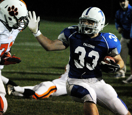 Danvers:<br /> Danvers' Jake Palazola runs the ball near the sidelines during the Beverly at Danvers football game at Deering Stadium.<br /> Photo by Ken Yuszkus/Salem News, Friday, October 21, 2011.