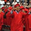 Salem:<br /> Bryan Feliz motions to the crowd as he files into the seating area during the processional into the Salem High gymnasium for the graduation.<br /> Photo by Ken Yuszkus/Salem News, Friday, June1, 2012.
