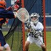 Danvers:<br /> Nick Triano, St. John's Prep lacrosse goalie, defends the net during a game at St. John's Prep.<br /> Photo by Ken Yuszkus/Salem News, Thursday, April 22, 2010.