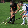 Danvers:<br /> Marblehead's Eliza Fitzgerald, left, and Danvers' Seth Kamens, reach for the loose ball at the Marblehead at Danvers High School field hockey game.<br /> Photo by Ken Yuszkus/Salem News, Monday, September 12, 2011.