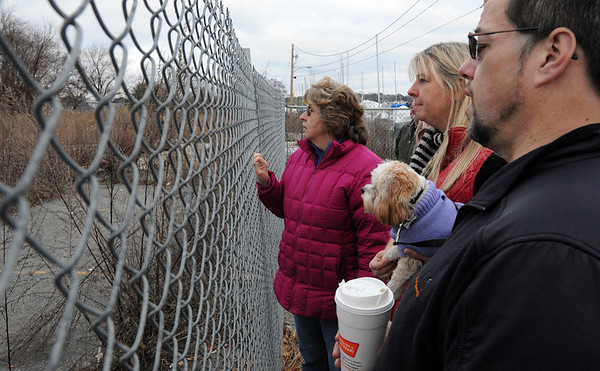 Danvers:<br /> From left, Janet Lettich, Katie Turcotte, and Gardner Trask, selectman, look at the site of the explosion on the 3-year anniversary of the explosion.<br /> Photo by Ken Yuszkus/Salem News, Sunday November 22, 2009.