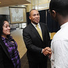 Danvers:<br /> Gov. Deval Patrick greets students Julisa Ordomez of Cambridge, left, and Jason Bance of Beverly, right, just before the governor's speech at North Shore Community College . The governor spoke about ARRA funding and a solar panel project for the Berry Building.<br /> Photo by Ken Yuszkus/Salem News, Thursday, February 25, 2010.