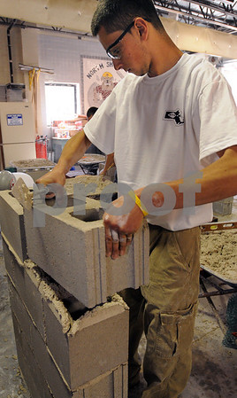 Middleton:<br /> Jonathan Costa of Salem, places a cinder block into the mortar while making a five course block wall during the masonry competition at the North Shore Technical High School.<br /> Photo by Ken Yuszkus/Salem News, Wednesday May 13, 2009.