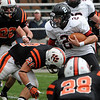 Beverly:<br /> Marblehead's Ryan Stanojev runs with the ball as Beverly's Nick Theriault tackles him during the Marblehead at Beverly football game in Hurd Stadium on Saturday.<br /> Photo by Ken Yuszkus/Salem News,  Saturday,  November 6, 2010.