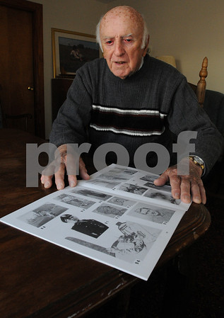 Beverly:<br /> George Coleman has compiled a booklet showing that all 153 members of the Beverly High School Class of 1940 --  including him, the class president and a bombardier on B-17's and B-29's -- all survived military service during World War II. There  is a photo of George on the page in the foreground in the middle row, on the closest edge of the page.<br /> Photo by Ken Yuszkus/Salem News, Monday November 9, 2009.