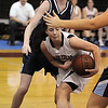 Marblehead:<br /> Marblehead's Lyndsey Cohen, right, protects the ball under Peabody's basket as Carolyn Scacchi of Peabody tries for it at the Peabody High School vs Marblehead High School girls varsity basketball game at Marblehead.<br /> Photo by Ken Yuszkus/Salem News, Tuesday, January 11, 2011.