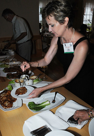 Salem:<br /> Sara Maurno tries some of the hors d'oeuvres samplers at Cafe Polonia. It was the Mayor's Night Out, which is part of Salem's Heritage Days.  Mayor Kim Driscoll was on a tour of three of Salem's dining spots: Cafe Polonia, Adriatic Restaurant & Bar, and Great Escape Restaurant.<br /> Photo by Ken Yuszkus/Salem News, Monday, August 8, 2011.