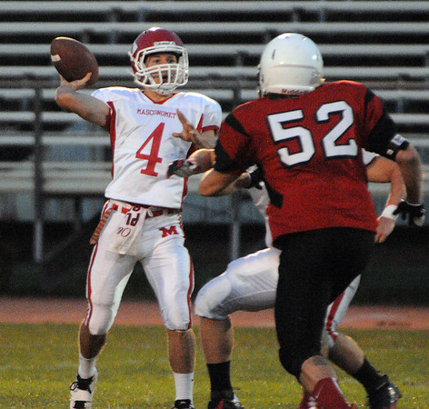 Salem:<br /> Masconomet's Chris Schleer throws the ball while being pressured by Salem's Alex Veloukas during the Masconomet at Salem football game.<br /> Photo by Ken Yuszkus/The Salem News, Friday, September 14, 2012.