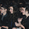 Beverly:<br /> Gaduates of Montserrat College of Art from left, Peter Bergamo, Brittany Armington, and Jordan Archey applaud the faculty remarks speech by Ron DiRito during graduation ceremonies.<br /> Photo by Ken Yuszkus/Salem News, Friday, May 25, 2012.