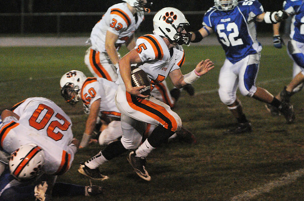Danvers:<br /> Beverly's Dom Abate runs through the line during the Beverly at Danvers football game at Deering Stadium.<br /> Photo by Ken Yuszkus/Salem News, Friday, October 21, 2011.