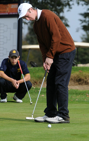 Beverly:<br /> St. John's Prep's Tim Cunningham putts on the 11th green at the Division 1 North golf sectionals at Beverly Golf and Tennis Club.<br /> Photo by Ken Yuszkus/Salem News, Monday, October 24, 2011.