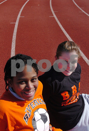 Beverly:<br /> Janelle Louis, left, and Helen Armore, Beverly High girls track captains, at the high school track.<br /> Photo by Ken Yuszkus/Salem News, Monday, March 23, 2009.