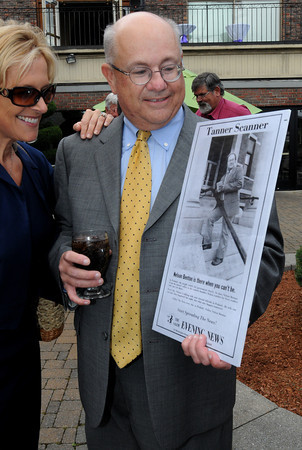 Danvers:<br /> The Salem News publisher Karen Andreas and Nelson Benton look at an old photo of Nelson at Nelson Benton's retirement party which was held at the Danvers Yatch Club.<br /> Photo by Ken Yuszkus/Salem News, Wednesday, June 27,  2012.