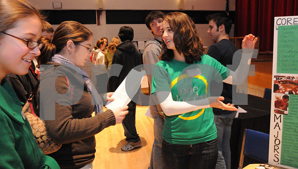 Salem:<br /> From left, Kayleigh Ristuben and Kelley McCarthy, both Salem High students, listen to Camille Wathne,   a graduate from Salem High and now a freshman at Loyola College talk about Loyola College at the high school Alumni College Fair.<br /> Photo by Ken Yuszkus/Salem News, Thursday,  January 8, 2009.