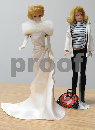 Beverly:<br /> Barbie with a bubble cut haircut, left, and Midge with blonde hair, both from 1961 or 1962, which is part of Jane Staufer's Barbie collection.<br /> Photo by Ken Yuszkus/Salem News, Tuesday March 3, 2009.
