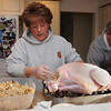 Beverly:<br /> Lyn Ego stuffs the turkey early Thanksgiving morning before she goes to the Salem at Beverly football game at Hurd Stadium to see her son Alex Ego play.<br /> Photo by Ken Yuszkus/Salem News, Thursday, November 25, 2010.