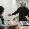 "Peabody:<br /> Suzanne Ryan, director of volunteer services and co-director of ArcWorks, speaks with Rod Parker, a Salem photographer who will be exhibiting at the Northeast Arc building in the ""Visions of the Past"" art exhibit.<br /> Photo by Ken Yuszkus/Salem News, Monday, February 28, 2011."