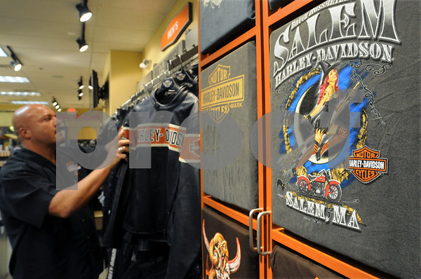 Salem:<br /> Michael Sienkiewicz, general manager of the Bruce Rossmeyer's Salem Harley-Davidson store that recently opened, near the leather jackets with the Harley-Davidson logo, which are part of the variety of merchandise available at the store. The t-shirts with the store logo are in the foreground.<br /> Photo by Ken Yuszkus/Salem News, October 7, 2008.