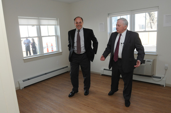 Beverly:<br /> Jack Meaney, left, CEO of the YMCA of the North Shore, and Beverly Mayor Bill Scanlon tour 9 Mill Street before the ribbon-cutting ceremony to mark completion of first phase and beginning of second phase of the Holcroft Park Homes development.<br /> Photo by Ken Yuszkus/Salem News, Friday, April 13, 2012.