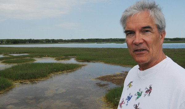 "Ipswich:<br /> William Sargent is an author and his latest book is ""The Well from Hell"", which is about the BP disaster. He is standing in the marsh environment near his home.<br /> Photo by Ken Yuszkus/Salem News, Monday, May 31, 2011."