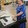 Hamilton:<br /> Amy Sprenkle places her ballot into the ballot box at the Winthrop School Thursday afternoon.<br /> Photo by Ken Yuszkus/Salem News, Thursday, May 26, 2011.
