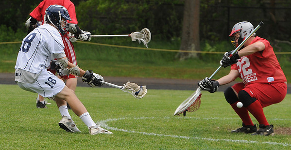 Hamilton:<br /> Hamilton-Wenham's Charles Serpa shoots for the net, but the ball is deflected by the Bishop Connelly's goalie during the Bishop Connolly at Hamilton-Wenham boys Lacrosse East Division 3 state tournament opening game.<br /> Photo by Ken Yuszkus/Salem News, Friday, June 3, 2011.